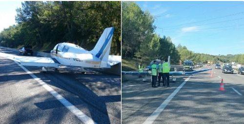 Un piccolo aereo da turismo atterrato in autostrada.